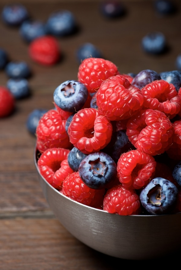 raspberries and blueberries in a bowl