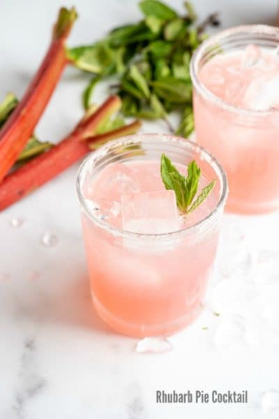 Refreshing, pink Rhubarb Pie Cocktail (a rhubarb vodka cocktail) with rhubarb in the background