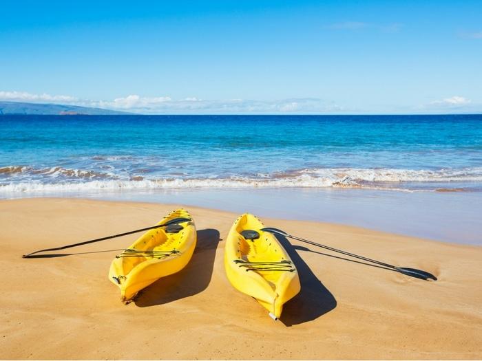 sea kayaks on a sunny beach