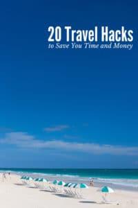 20 Travel Hacks (titled photo) Blue and white beach umbrellas on sandy beach