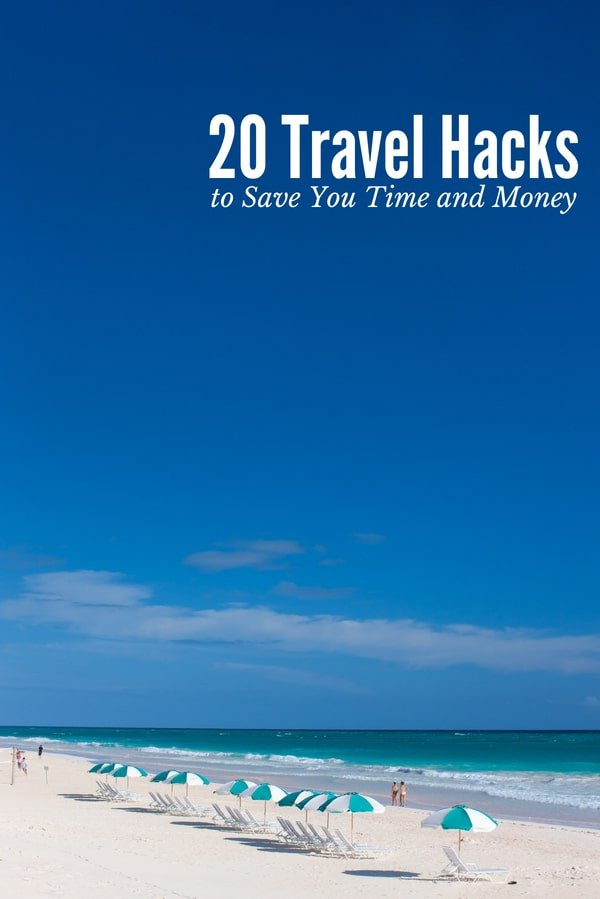 20 Travel Hacks (titled photo) Blue and white beach umbrellas on sandy beach