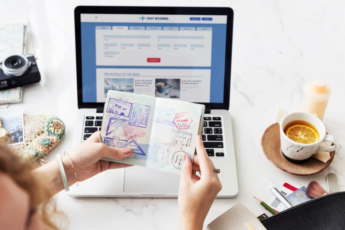 passport and laptop computer travel planning