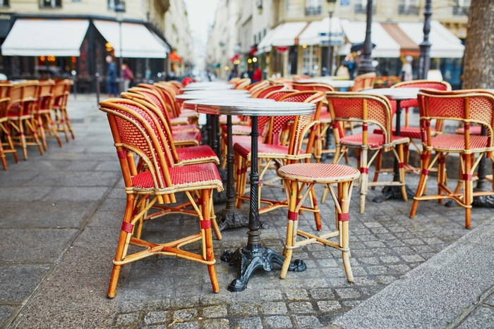 red chairs at outdoor Paris cafe