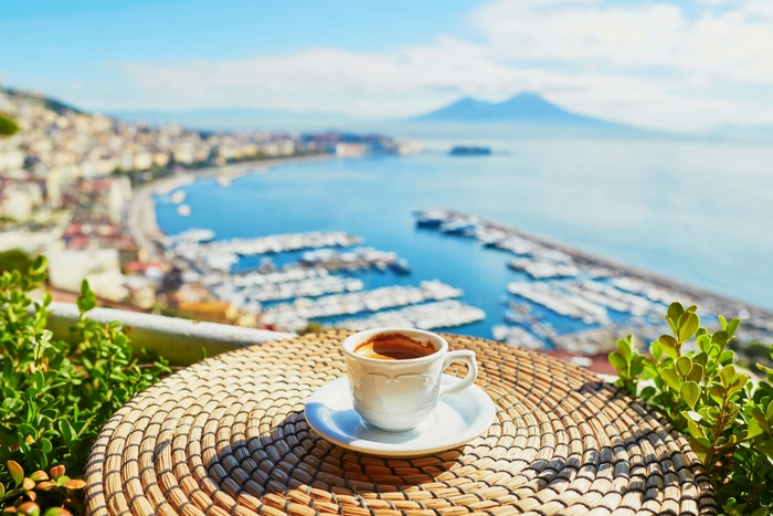 coffee on table overlooking a harbor