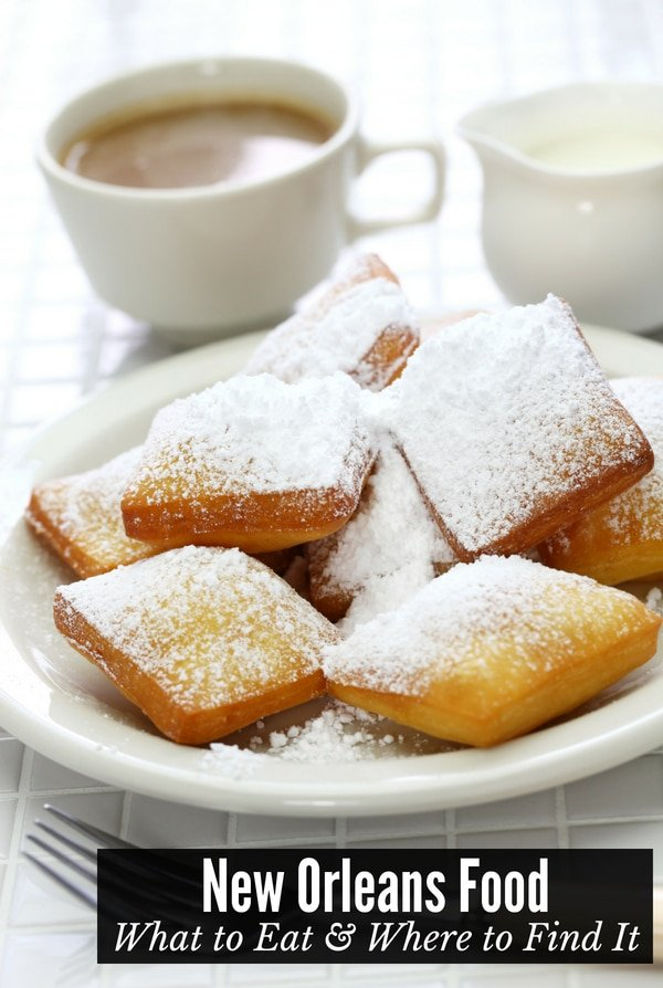 New Orleans food: Beignets on a white plate with coffee
