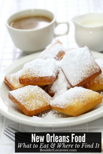 New Orleans food: Beignets on a white plate with coffee and cream
