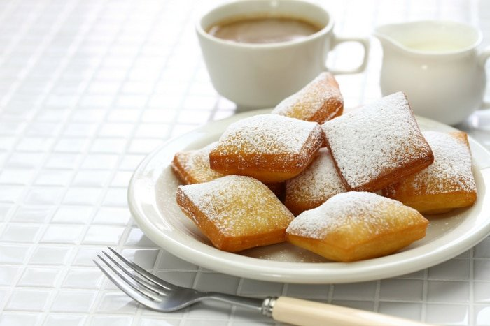 Beignets with cup of coffee