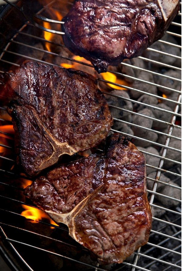 T-Bone steaks on grill