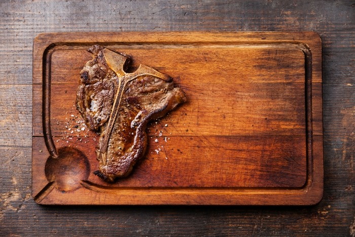 T-Bone steak on wood cutting board