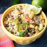 mexican quinoa - salad or side dish in yellow bowl