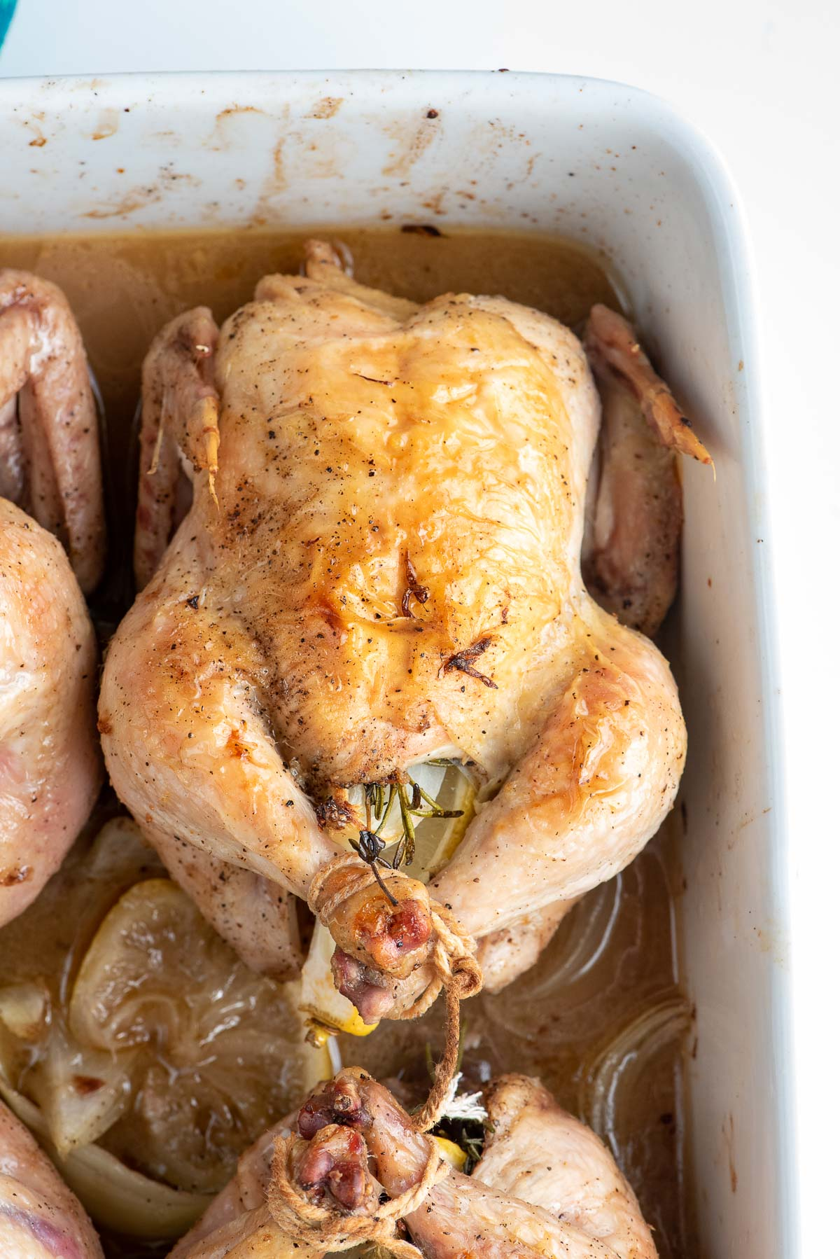 trussed Cornish hens cooked in pan