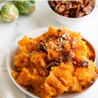 Mashed Instant Pot Sweet Potatoes in a white bowl