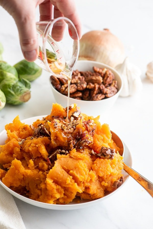 Mashed Sweet Potatoes with maple syrup drizzling on top