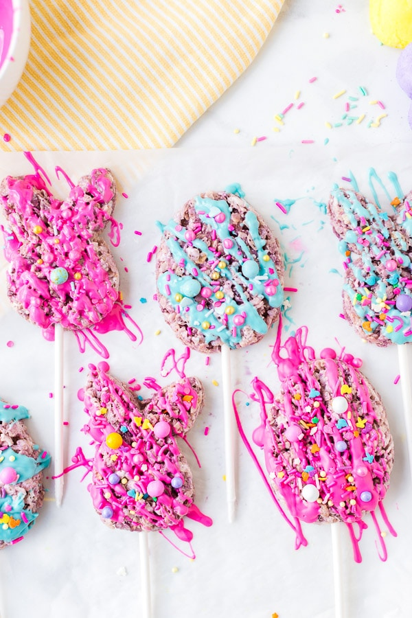 cookie cutter with rice krispie treat on stick drizzled with melted chocolate decorated