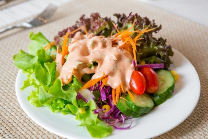 pink dressing on salad