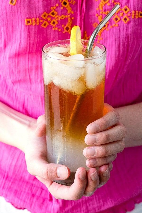 an Arnold Palmer drink in hands