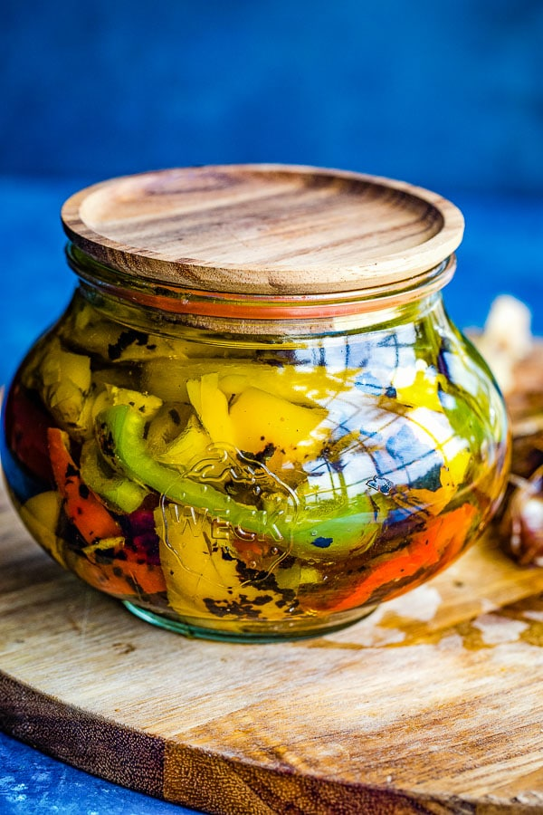 roasted peppers in jar with oil