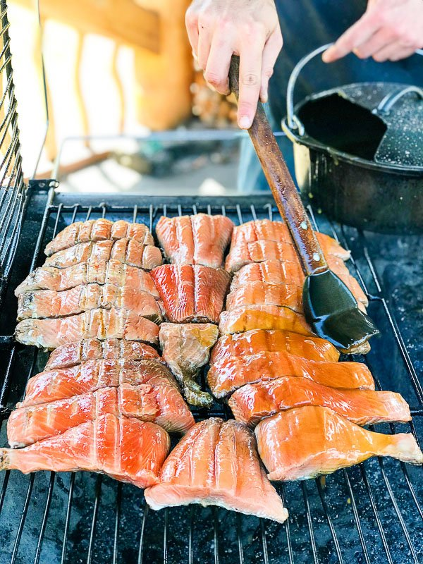 grilling salmon at Taku Lodge