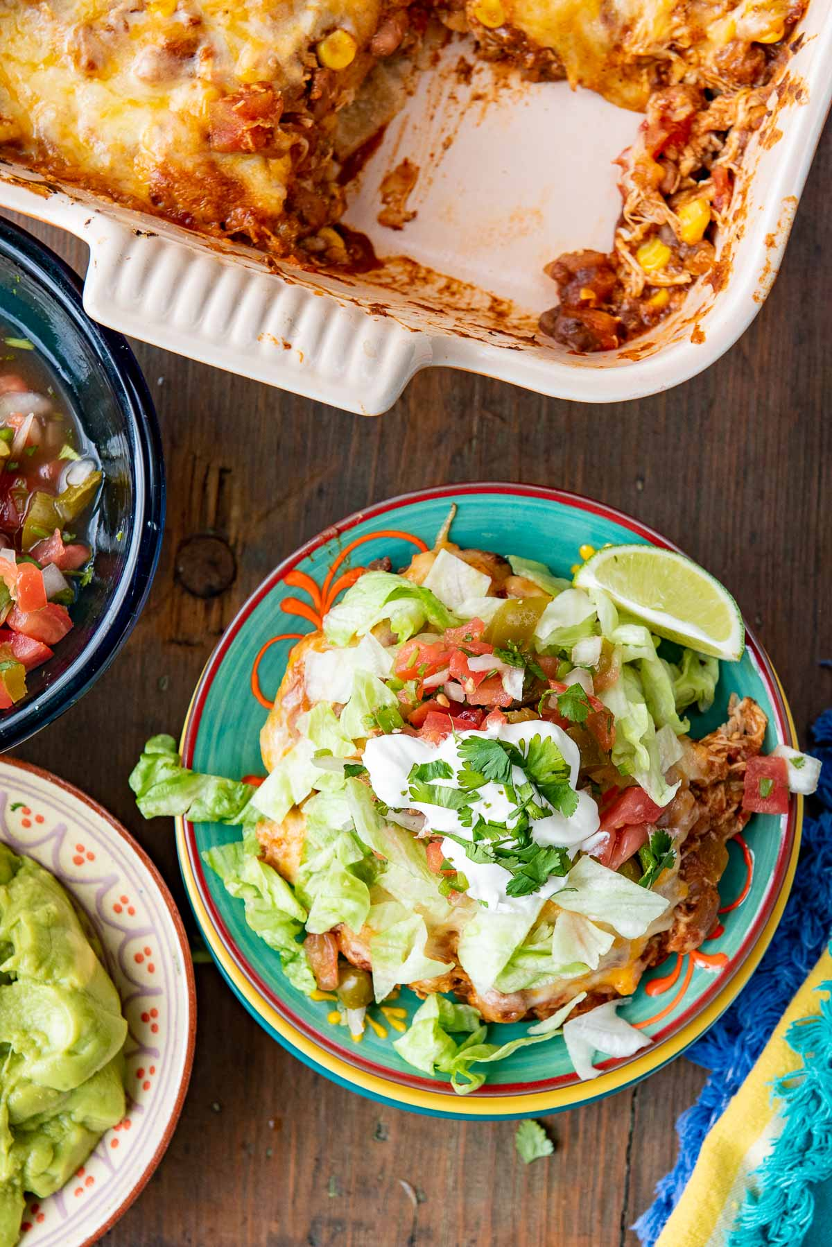 mexican chicken casserole on plate with toppings