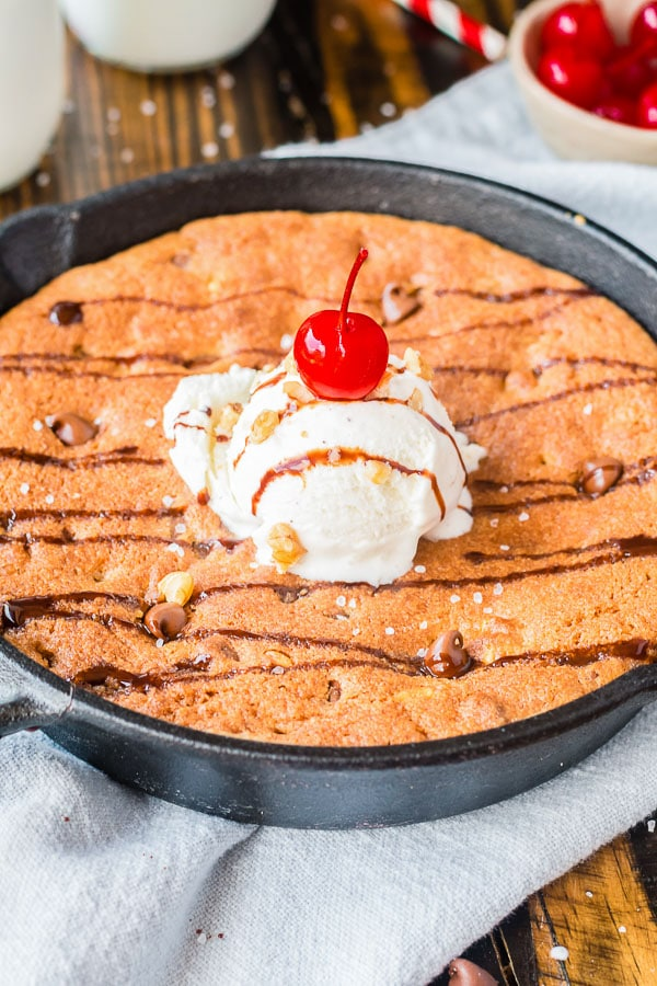 pizookie cookie in skillet topped with ice cream scoop