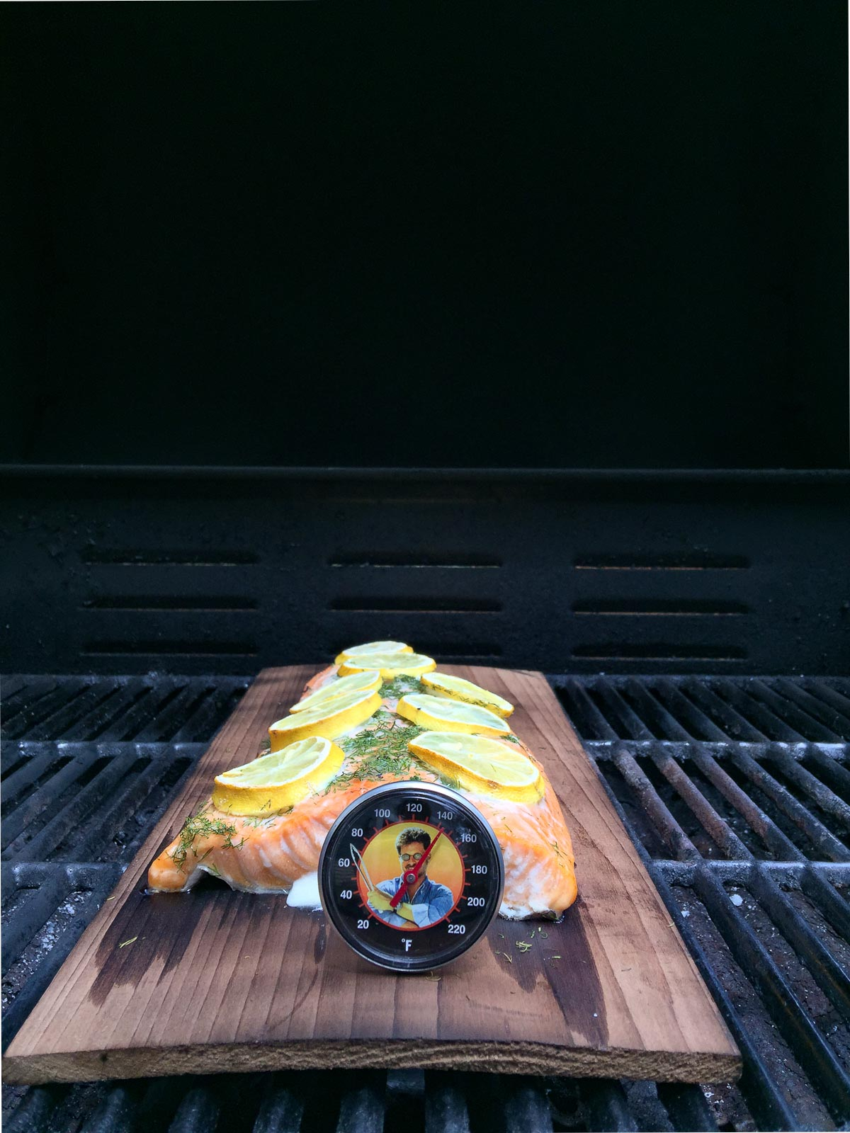 salmon on cedar plank with thermometer