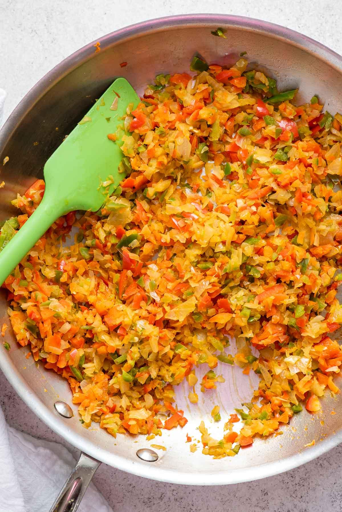 sautéing vegetables for shakhuka sauce