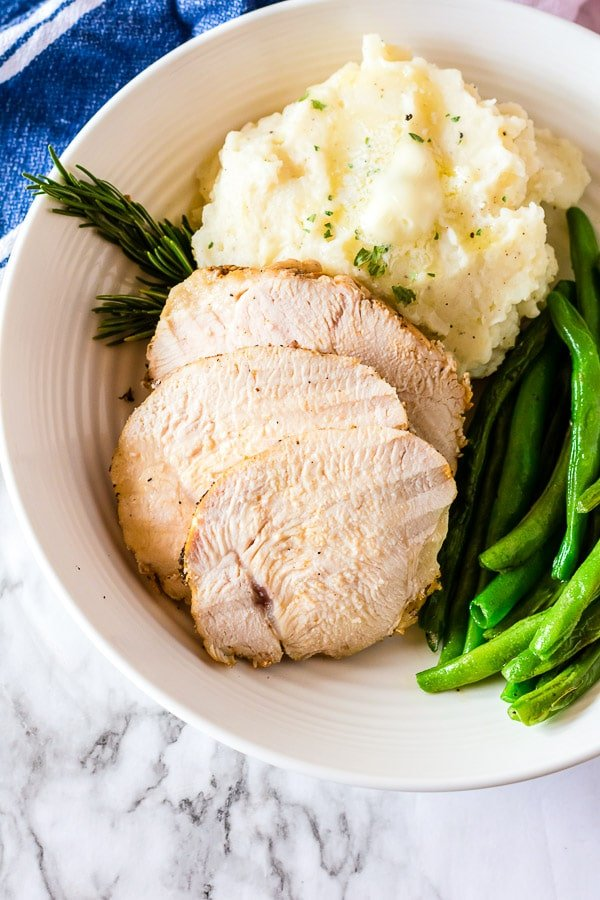 juicy turkey breast sliced with potatoes and green beans