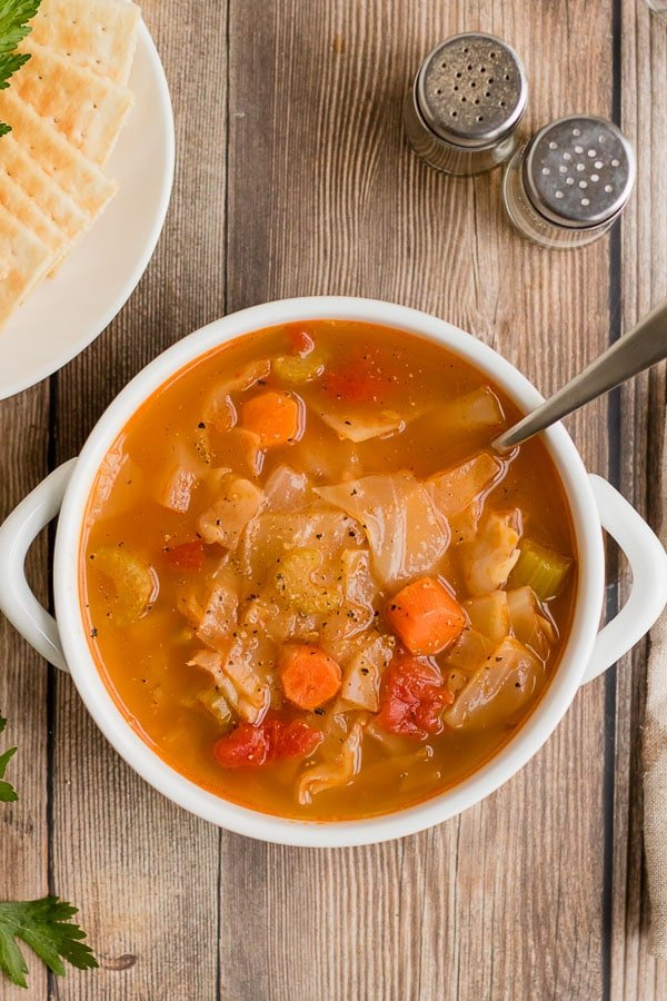 overhead white bowl of cabbage soup