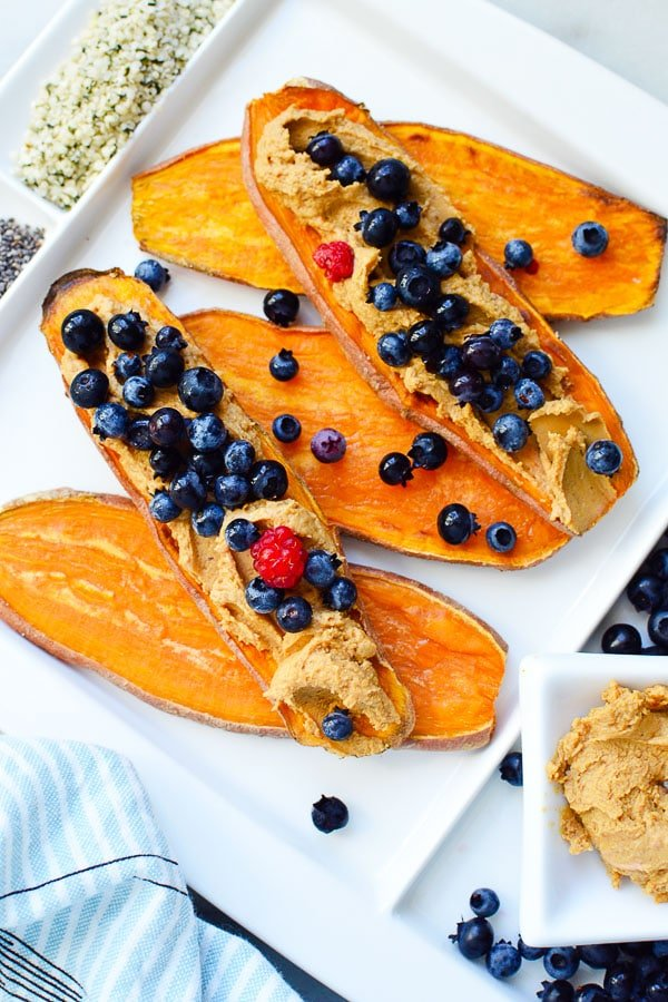 sliced sweet potato toast with nut butter and blueberries