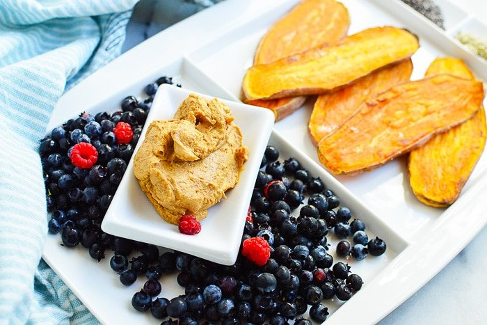 sliced sweet potatoes with nut butter and fruit