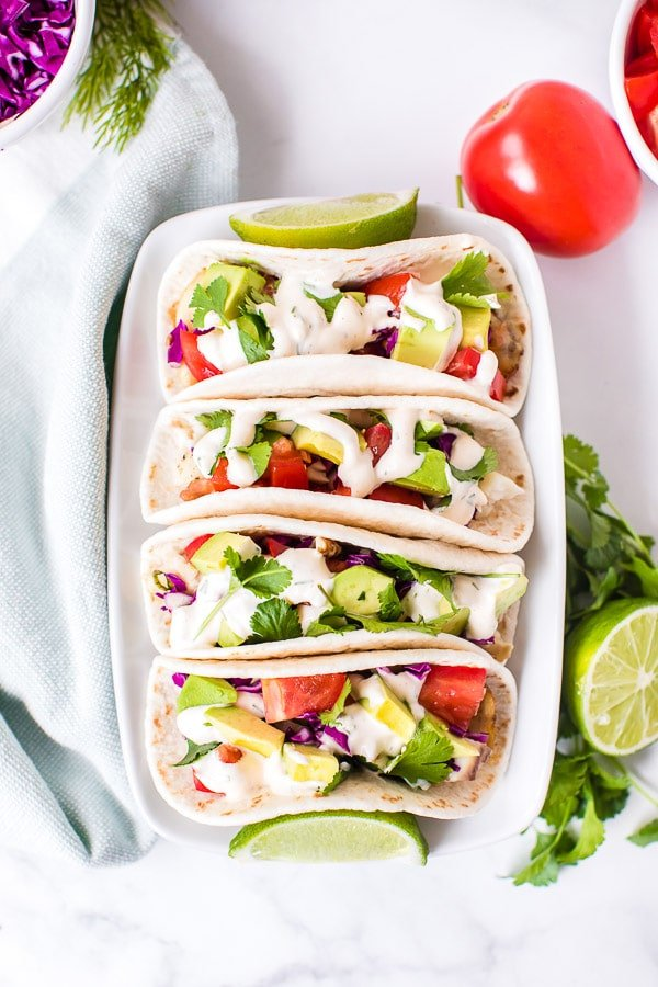 assembling fish tacos - platter of finished tacos