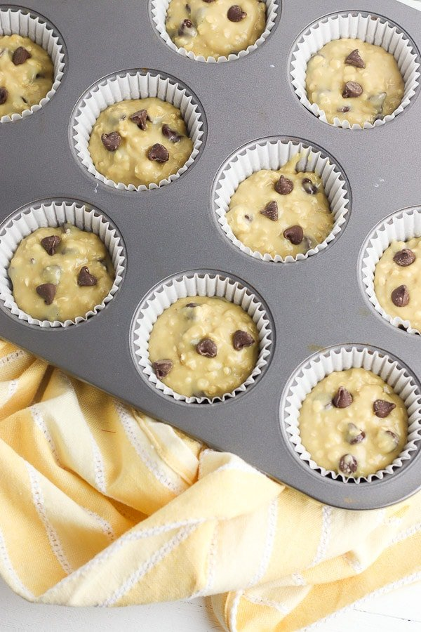 chocolate chip muffin batter in muffin pan before baking