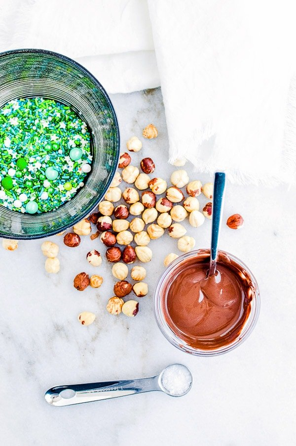 green sprinkles, hazelnuts and melted chocolate