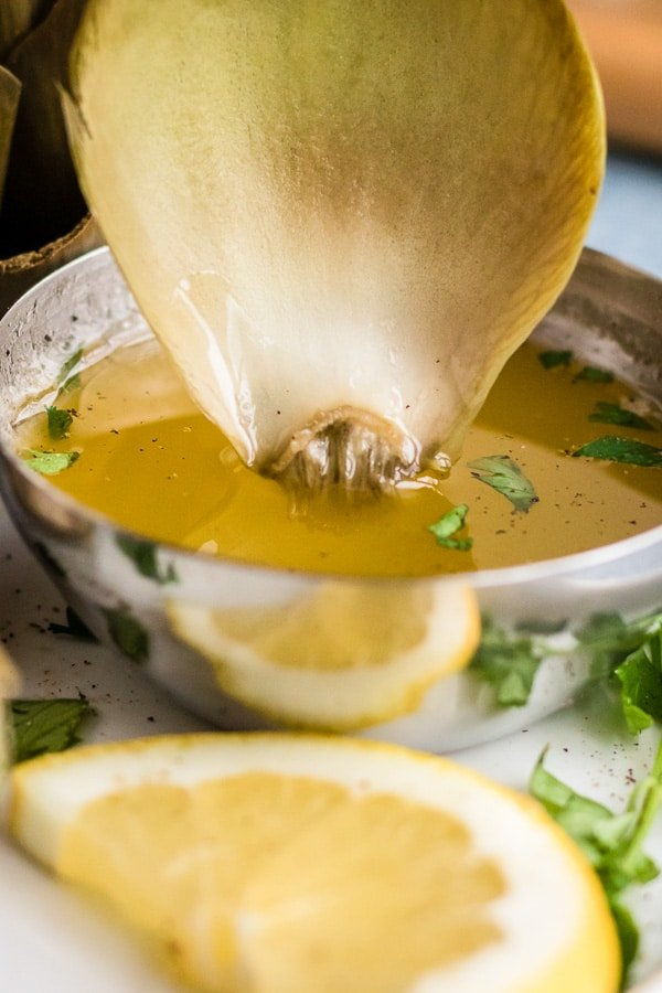 herb butter with dipping artichoke leaf