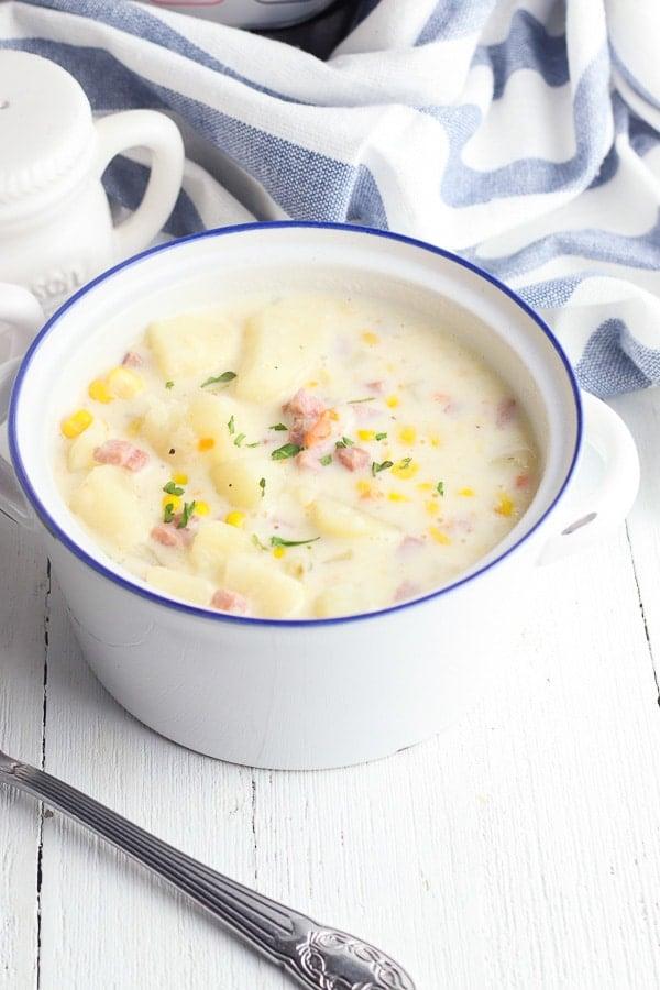 Bowl of potato corn chowder bowl with spoon