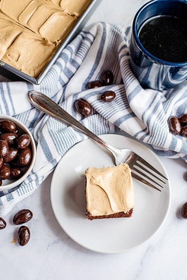 Espresso Wacky Cake slice on a plate above