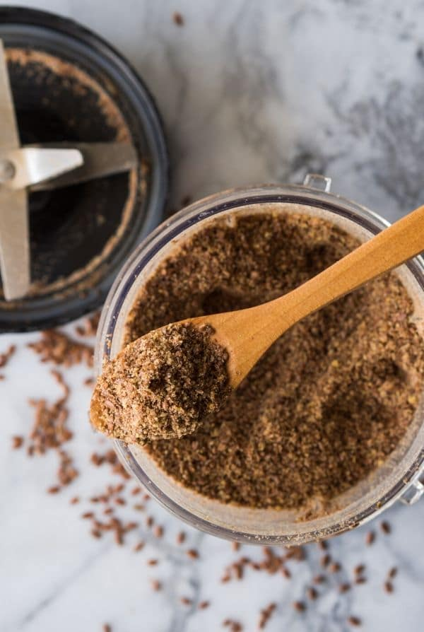 ground flaxseed on a spoon