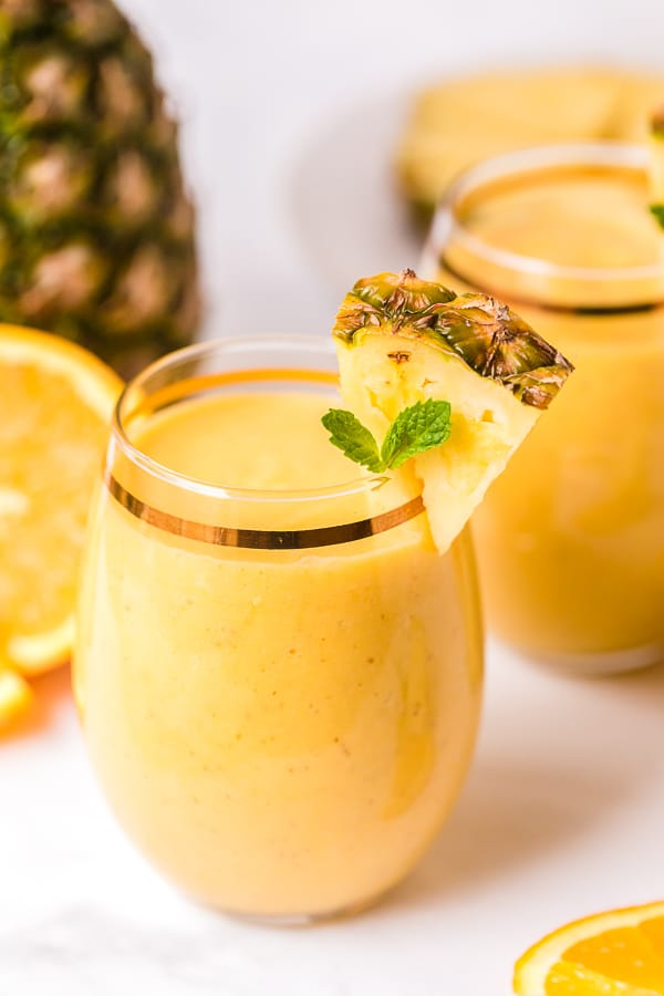 tropical smoothie recipe with pineapple garnish