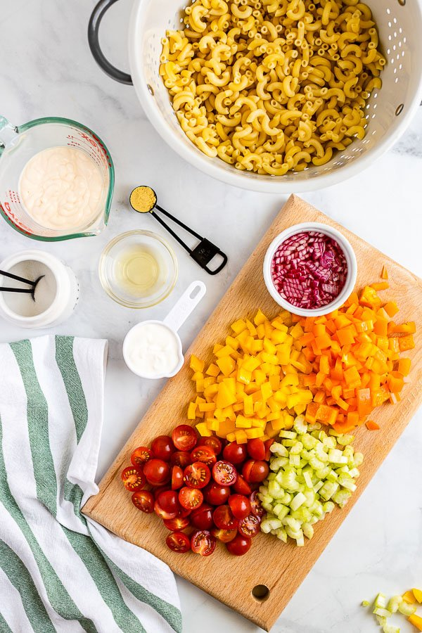 colorful ingredients for Macaroni Salad and dressing