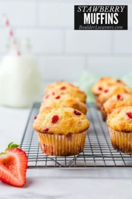 strawberry muffins on cooling rack with title text
