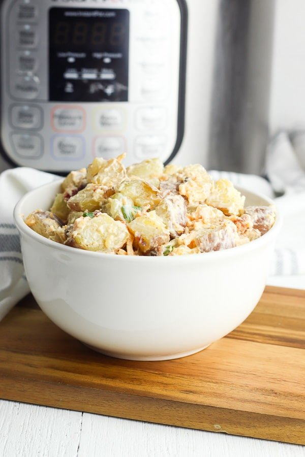 instant pot and baked potato salad with an Instant Pot in background