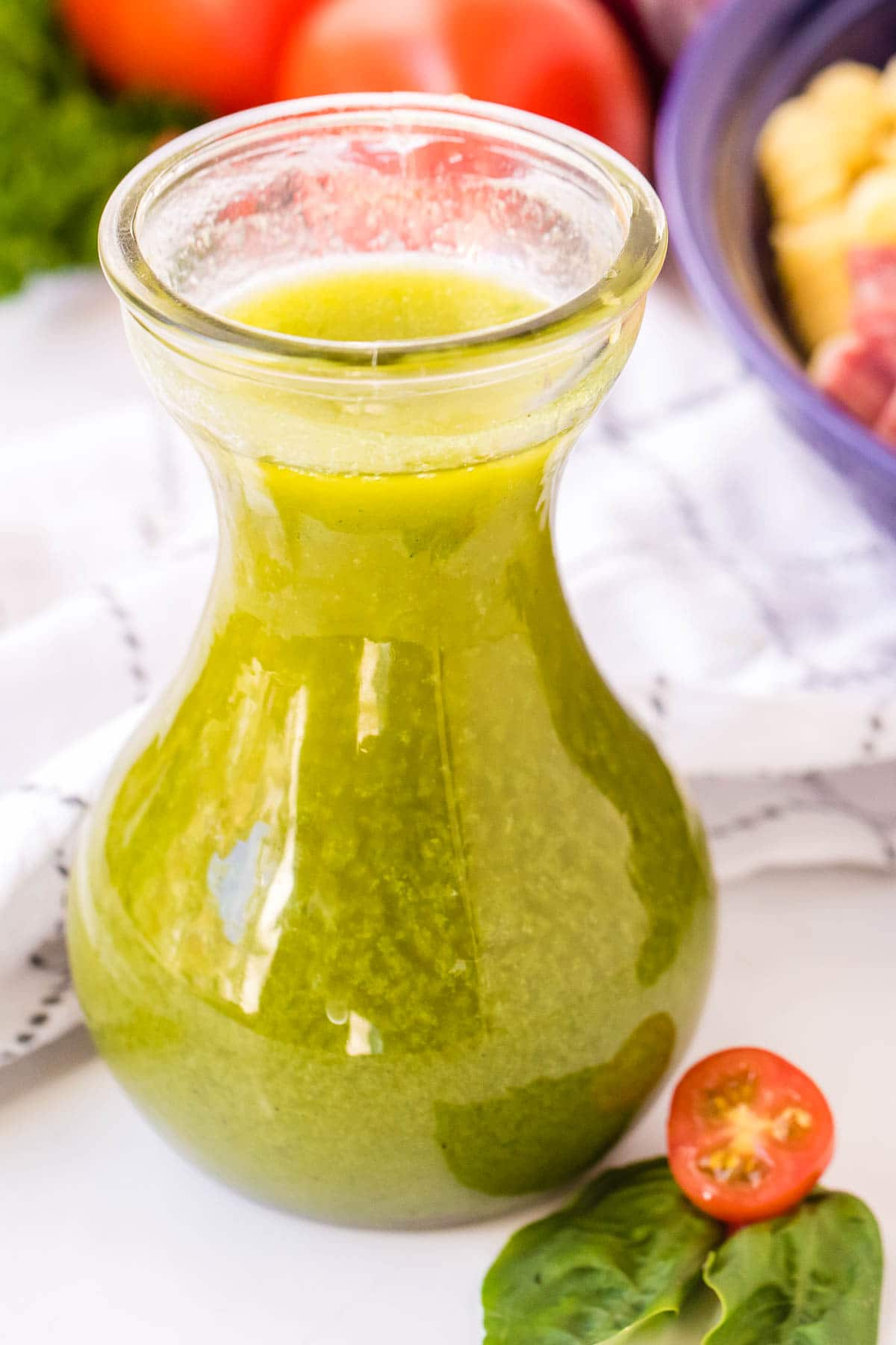 glass carafe of Italian Dressing for pasta salad