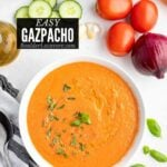 bowl of gazpacho soup with vegetable ingredients around title image
