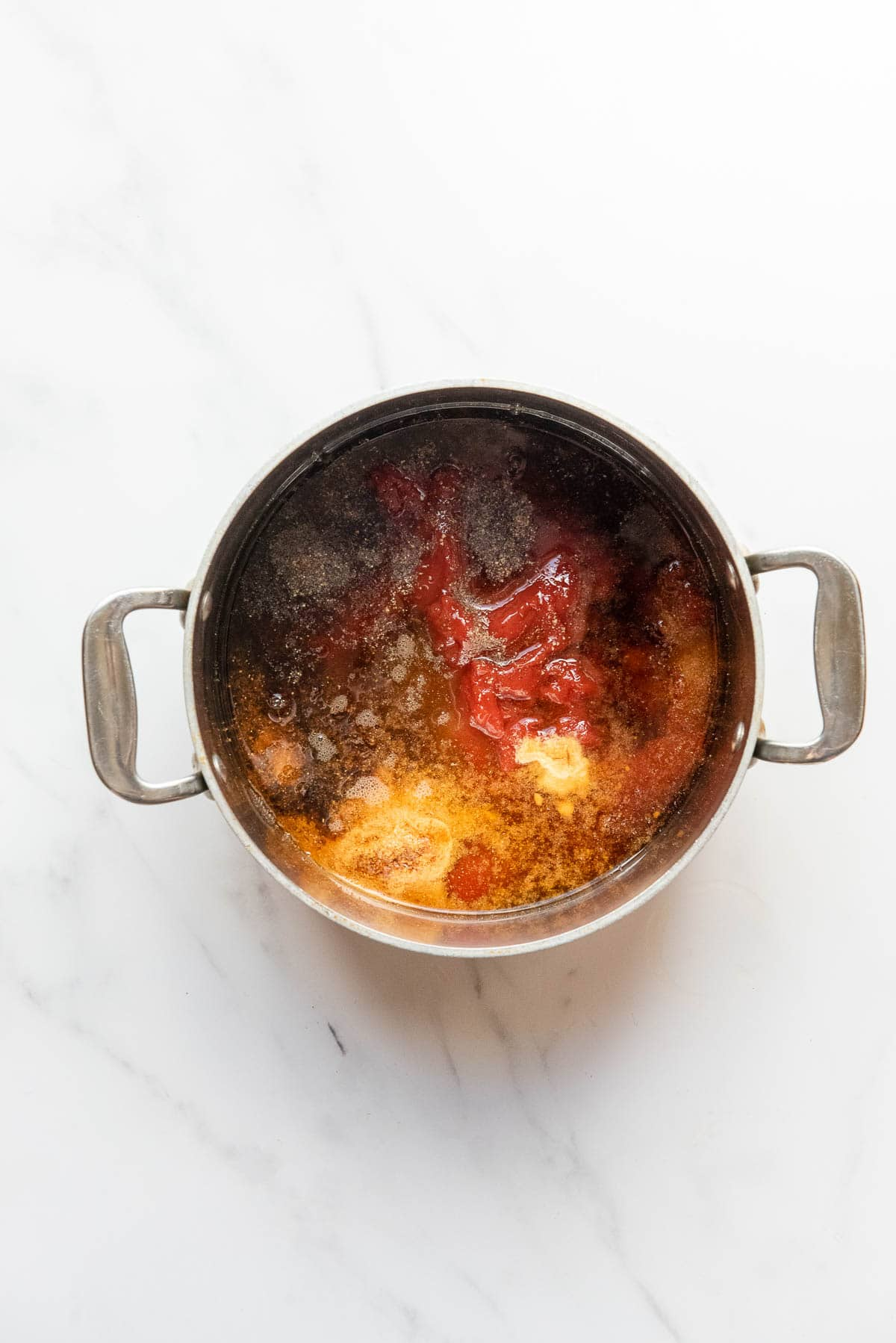 ingredients for homemade barbecue sauce in a sauce pan