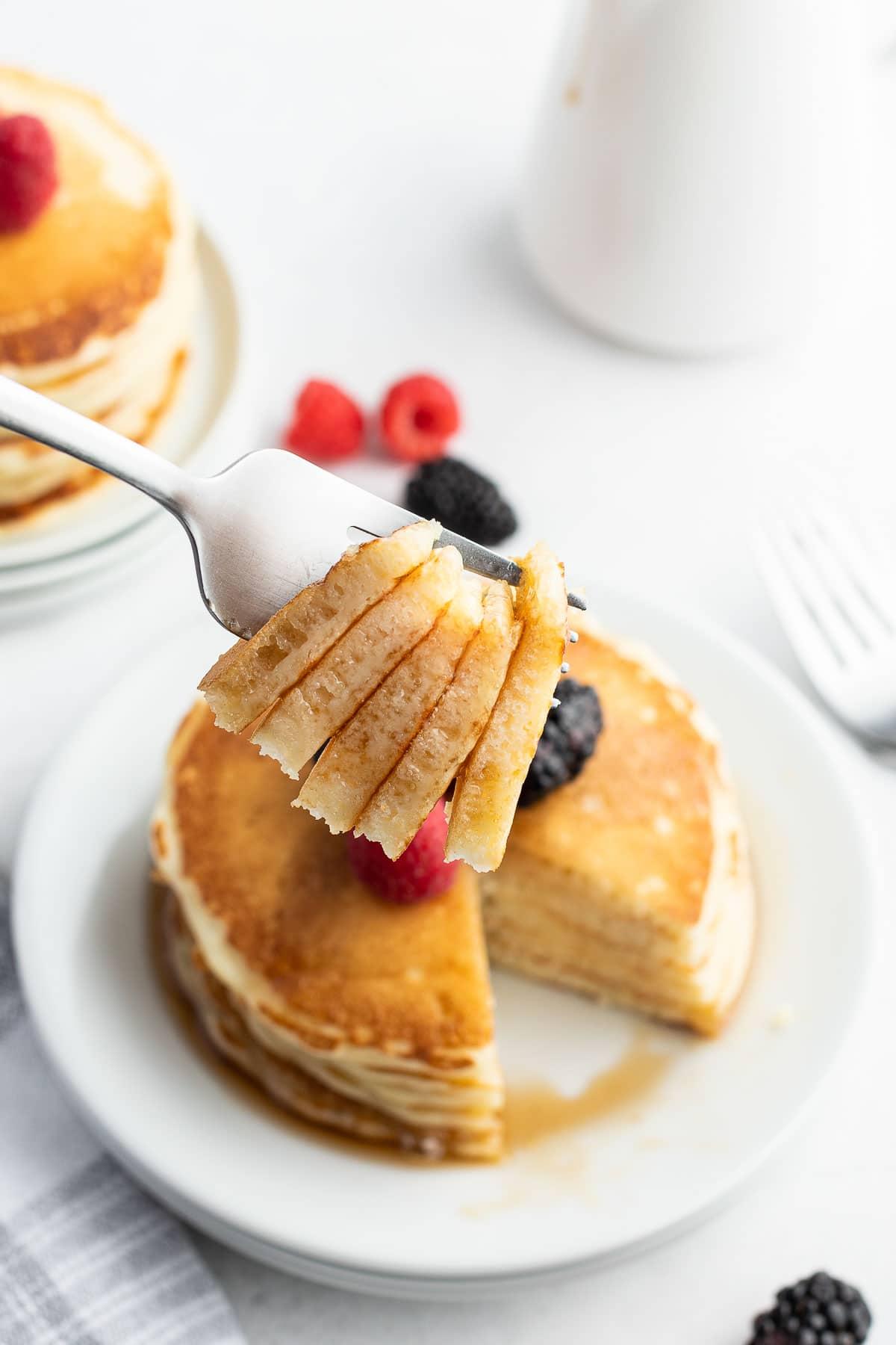 buttermilk pancakes bite on fork close up