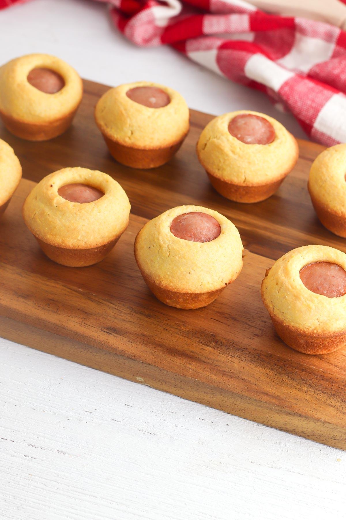 mini corn dogs on cutting board