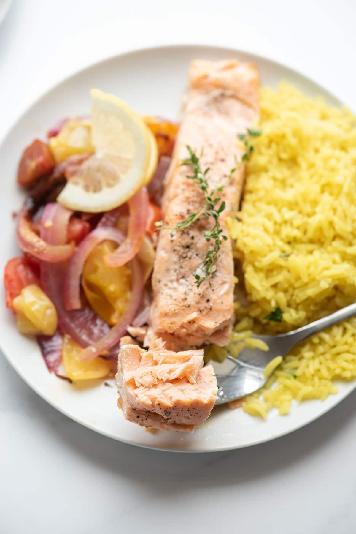 bite of salmon on fork