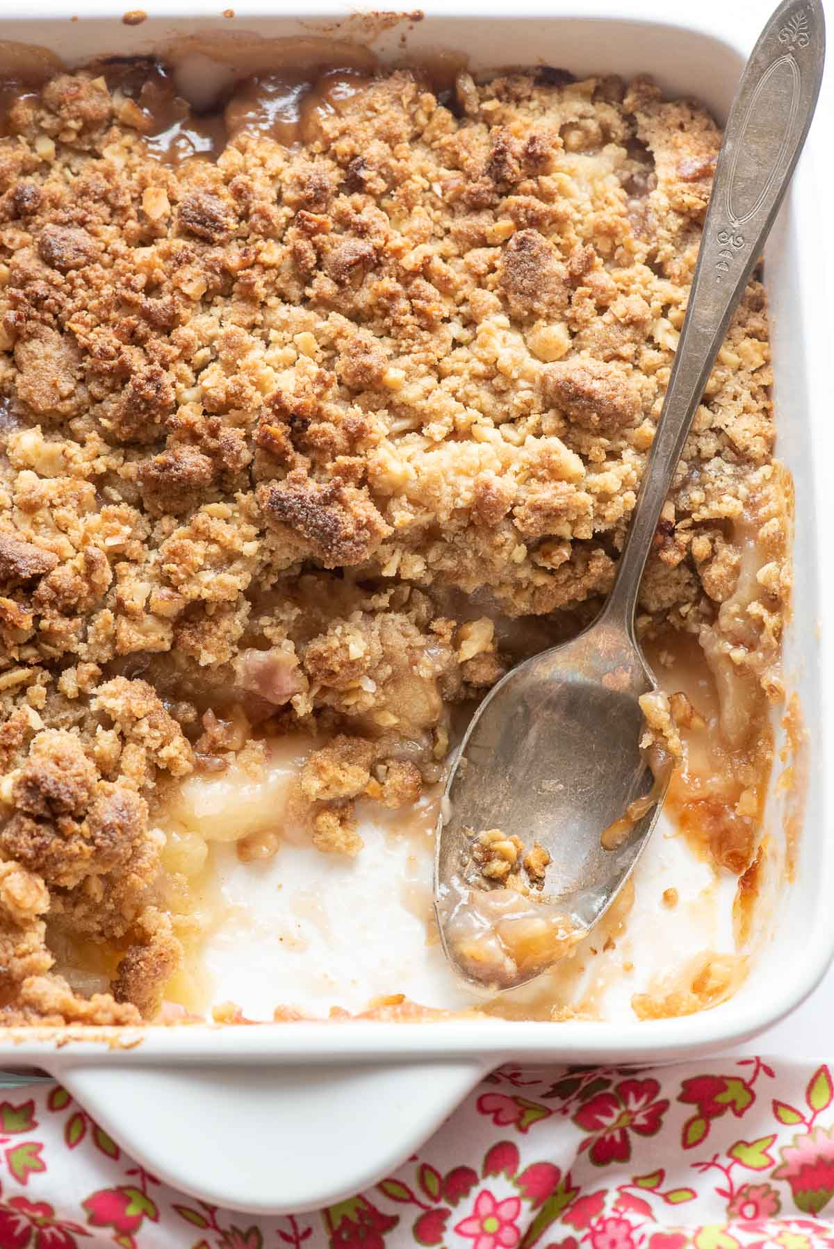 cooked peach crumble with scoop out
