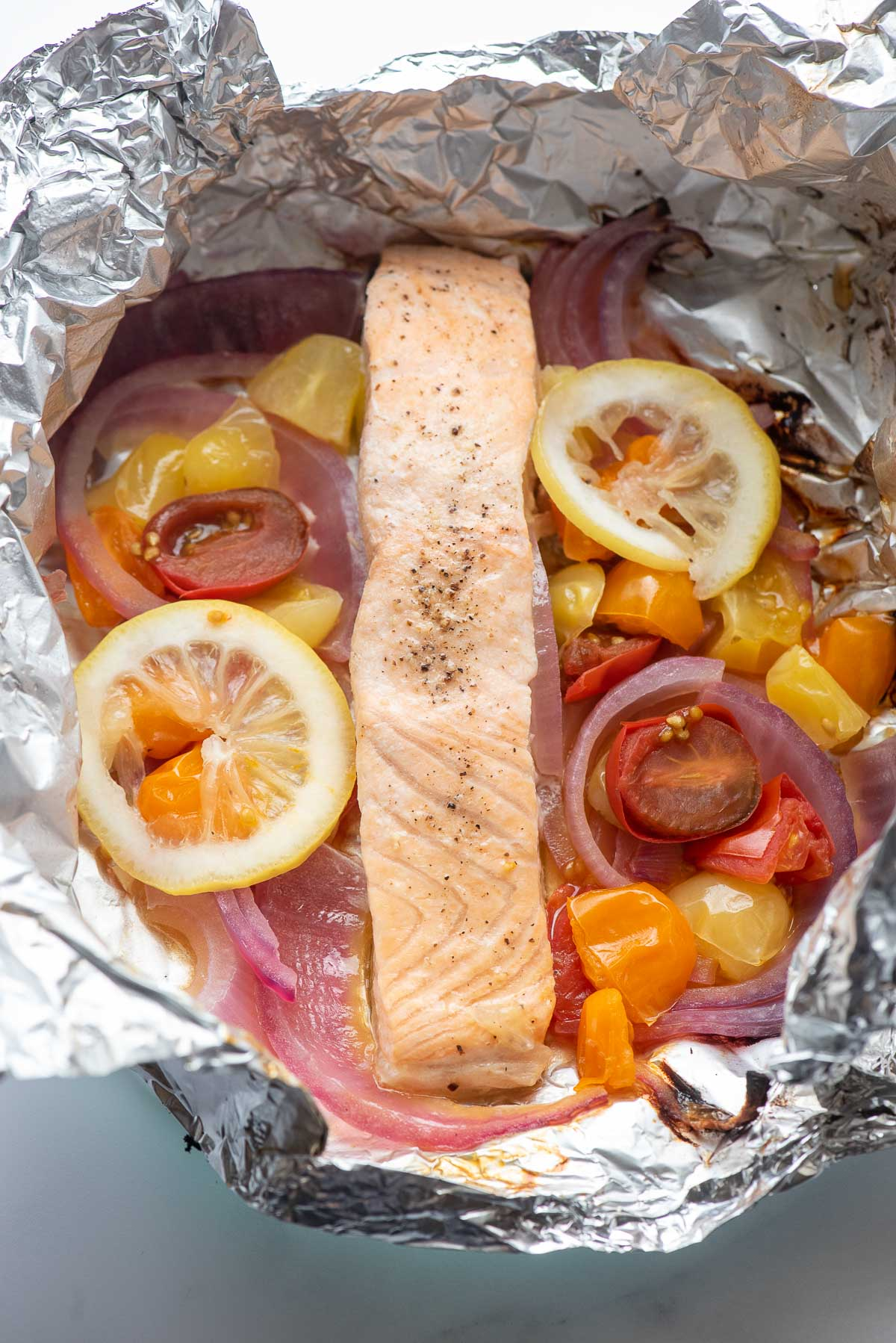 cooked salmon with vegetables in foil