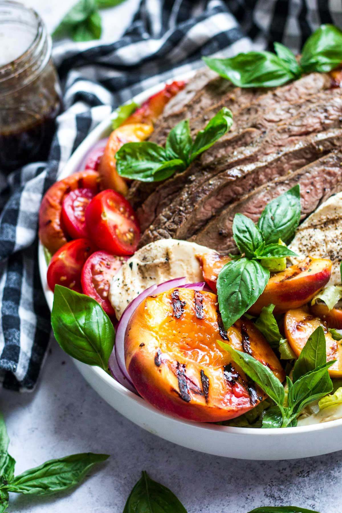 steak salad with grilled peach